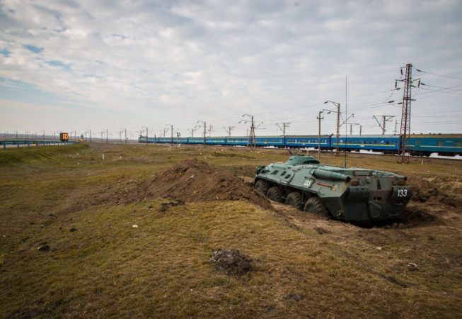 Ukrainian APC entrenched in on the border with Crimea after Crimea was annexed by Russia.  Russian annexation of Crimea was not recognized by international community and led to sanctions against Russia