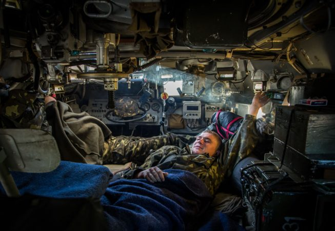 Ukrainian Army soldiers are resting inside an APC near Sloviansk,  Ukraine