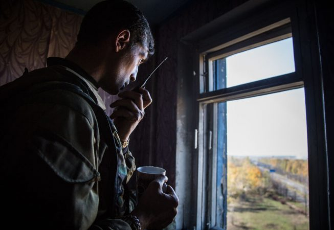 """Givi"", a separatist commander is directing fire towards Donetsk airport from a destroyed apartment in a 9-story condo"
