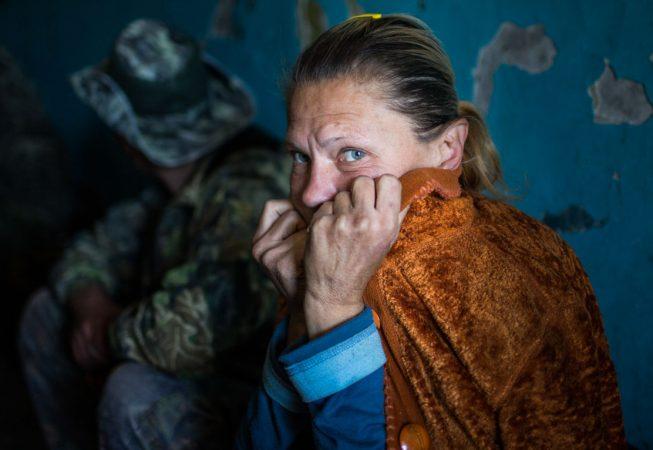 During shelling Irina has to hide in the only concrete building in the area - a condo near Donetsk airport.  The condo is also used by separatist fighters as a command post and firing position