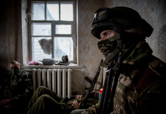 A serviceman of Ukrainian OUN volunteer battalion rests inside occupied house in the village of Peski, West of Donetsk.