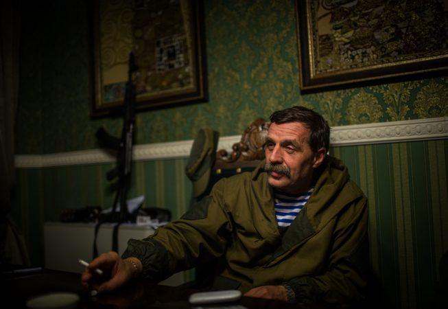 "Igor Bezler also known as ""Bes"", a rebel field commander,  smokes inside his office in Gorlovka,  Donetsk region, Ukrane"