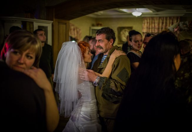 "Igor Bezler also known as ""Bes"", a rebel field commander,  dances with the bride at the wedding of his unit members in Gorlovka,  Donetsk region, Ukrane"