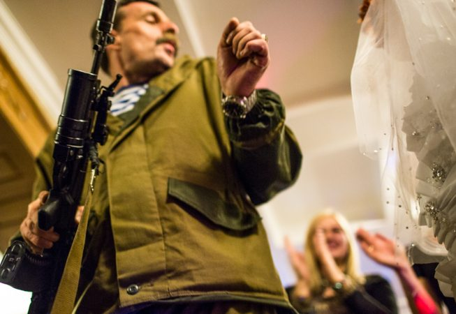 "Igor Bezler also known as ""Bes"", a rebel field commander,  dances with the bride holding his AK assault rifle  at the wedding of his unit members in Gorlovka,  Donetsk region, Ukrane"
