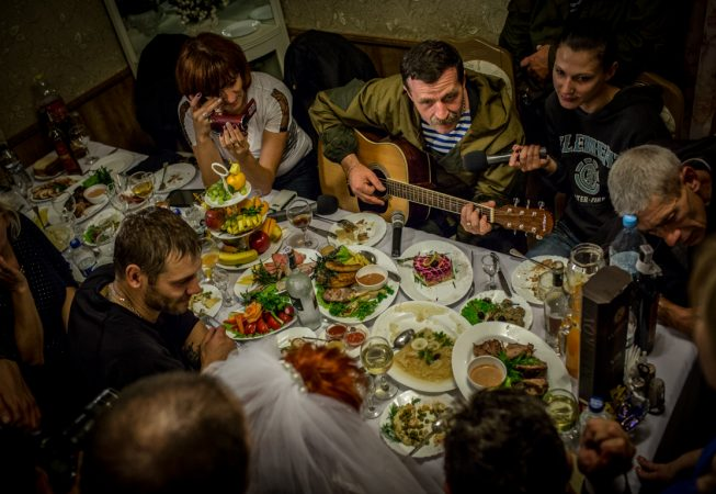"Igor Bezler also known as ""Bes"", a rebel field commander,  plays guitar at the wedding of his unit members in Gorlovka,  Donetsk region, Ukrane"
