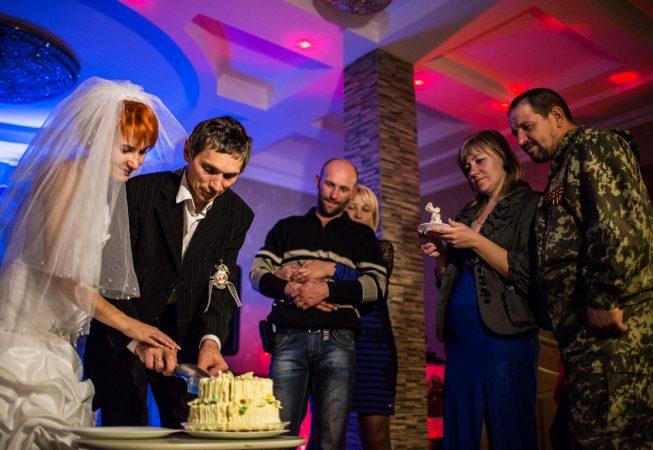 Wedding cake is cut at the rebel wedding  in Gorlovka, Donetsk region, Ukrane