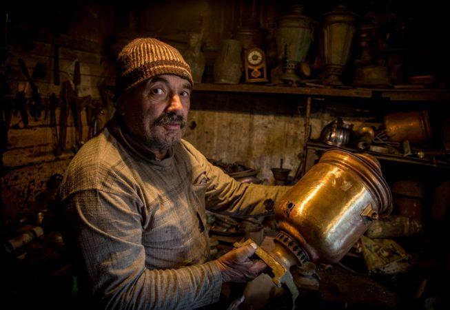An antique restorer at work