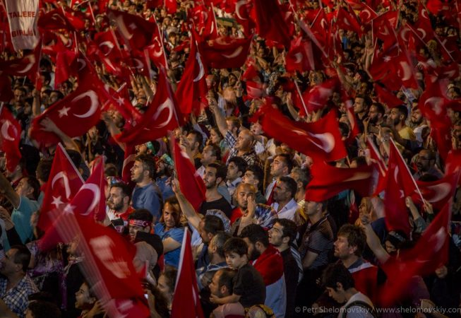 Thousands of red flags fly over Taksim square in Istanbul as Pro-government supporters celebrate failed coup attempt. Turkey