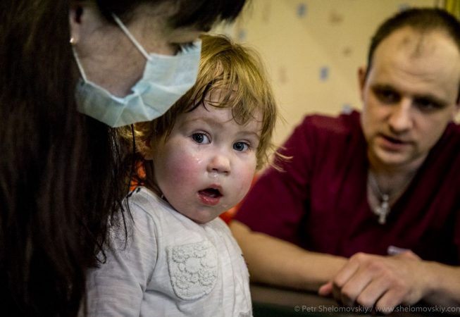 2 yo Katya is attending a cerebral palsy therapy in Radimichi NGO office in Novozybkov in Western Russia