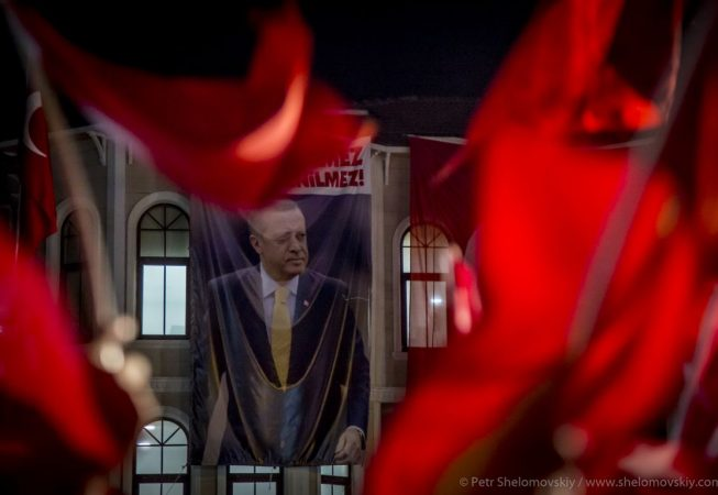 Five-meter tall image of President Erdogan hangs on the wall of his house in Uskudar district of Istanbul, Turkey. Pro-Erdogan crowd waves flags and chants until early morning during the celebrations of the failed coup attempt