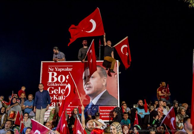 A billboard with the image of the Turkish president is mounted in front of his house in Uskudar district of Istanbul, Turkey. Pro-Erdogan crowd waves flags and chants until early morning during the celebrations of the failed coup attempt